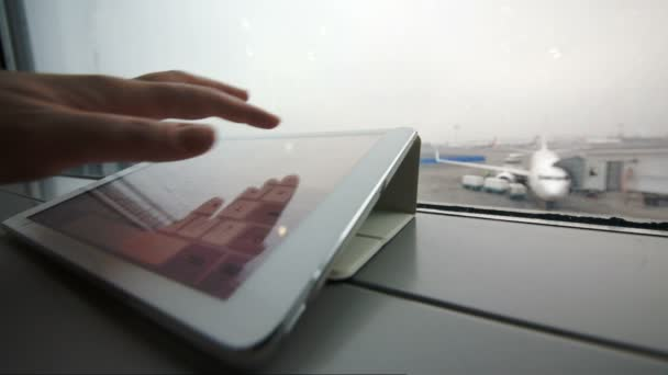 Using tablet PC on windowsill at the airport