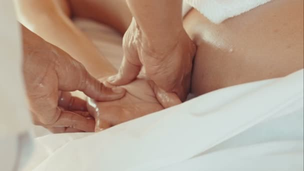 Massage of palm and fingers in beauty spa