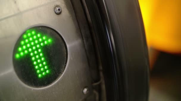 Green arrow indicator on working escalator