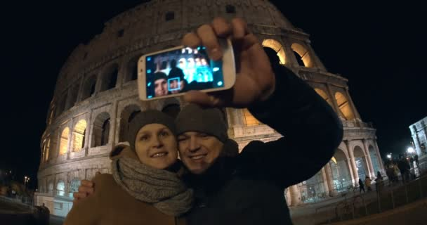 Couple making selfie in Rome at night