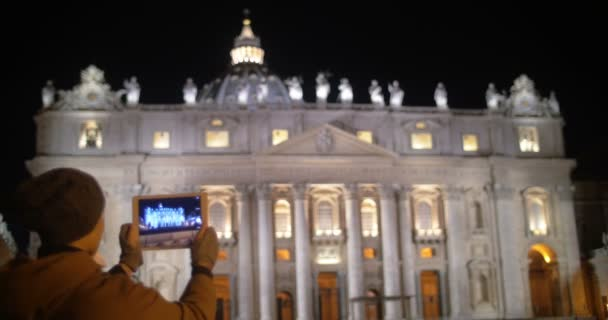 Taking pictures of night St. Peters Basilica