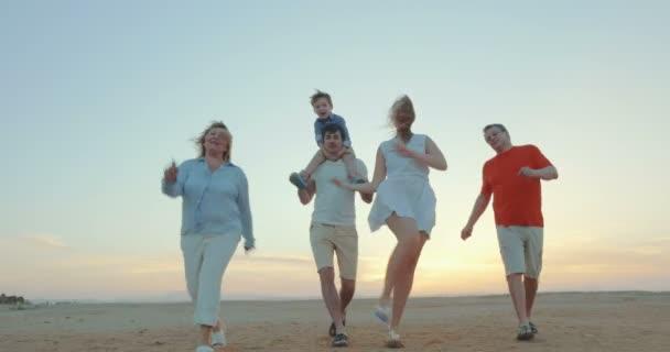 Enjoable family walk on the beach