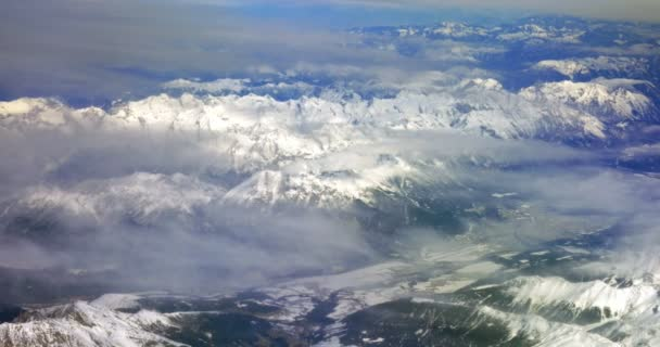 Flying over the snowy mountains