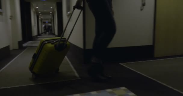 Woman tourist with suitcase arriving in the hotel