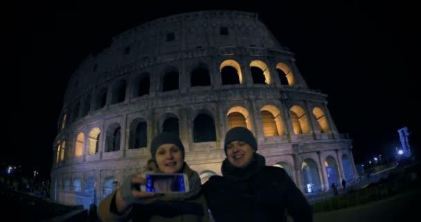 Young couple making selfie near Coliseum