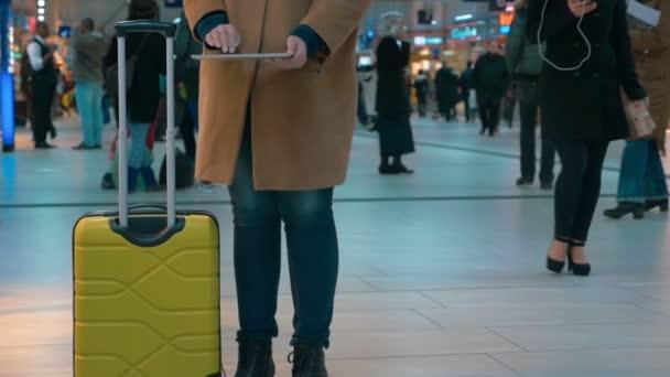 Woman traveler using pad at the airport