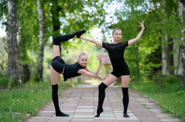 Warm-Up of Teen Rhythmic Gymnasts