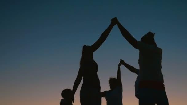 Family Round Dancing at Night