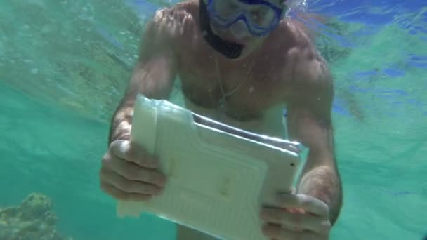 Man Shooting Coral Reef with Tablet PC
