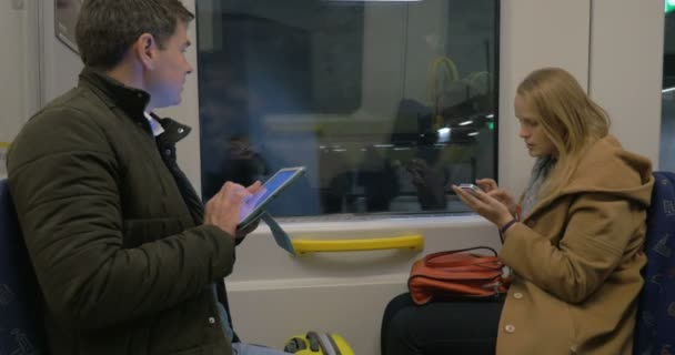Family Travels In A Train With Digital Tablets