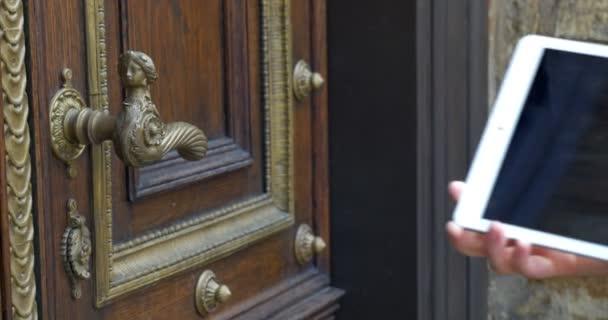 Taking shot of vintage door with pad
