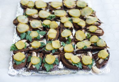 Sandwiches with sprats and pickles