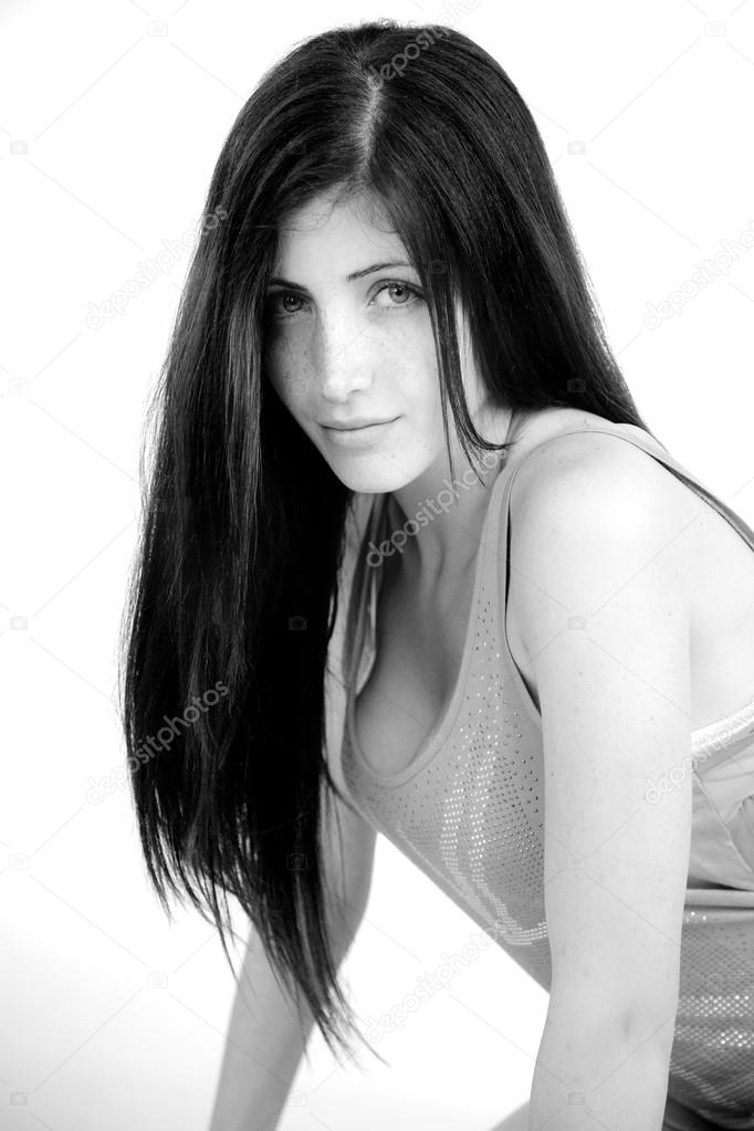 Black and white portrait of cute woman with freckles stock photo