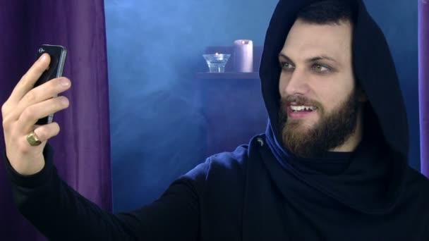Happy man in vampire costume