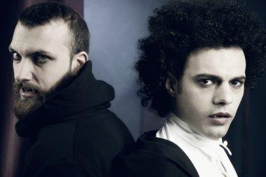 Two elegant handsome vampires looking camera