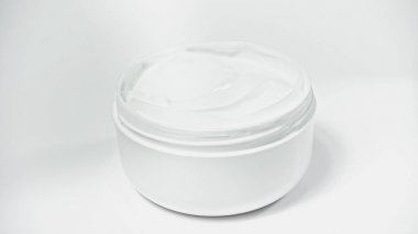 Jar with moisturizing cosmetic product on white stock vector