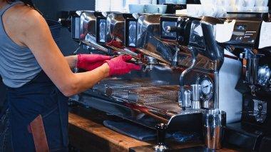 Partial view of barista holding portafilter in coffee shop stock vector
