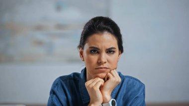 Upset young woman looking at camera at home stock vector