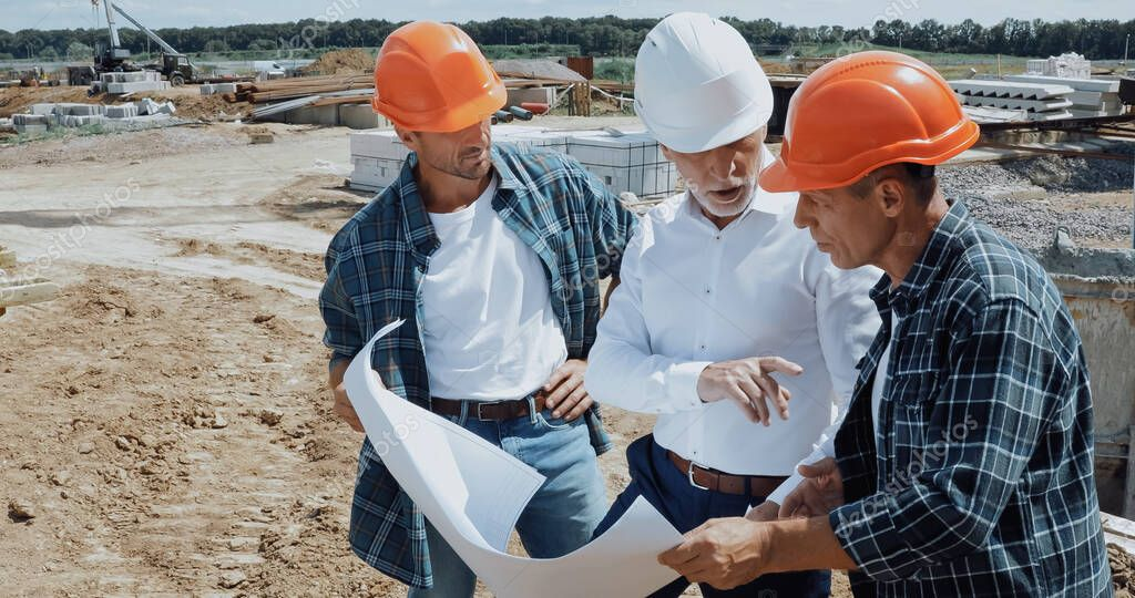 Engineer and builders discussing blueprint on construction site stock vector