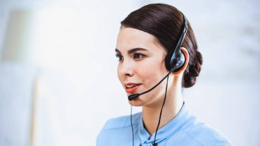 Portrait of smiling call center operator in headset stock vector