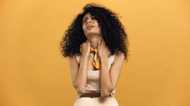 Hispanic woman feeling neck pain isolated on yellow stock vector