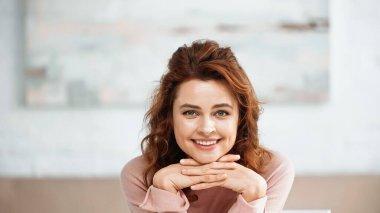 Smiling woman looking at camera at home stock vector