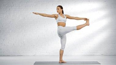 Fit woman doing dancing shiva yoga pose stock vector