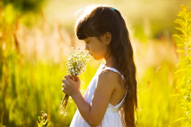 Girl with a bouquet of wildflowers