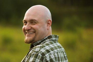 Bald gay men in plaid shirt