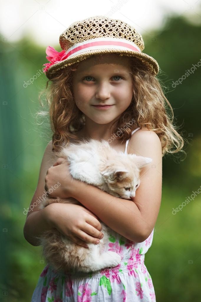 Cute little girl with a kitten