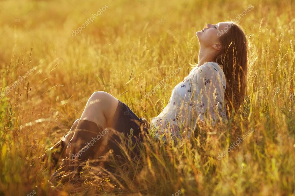 Happy woman sitting in the grass
