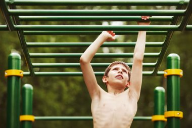 Teen exercise on the playground