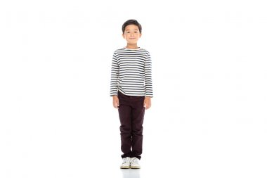 Full length of asian boy looking at camera on white background stock vector