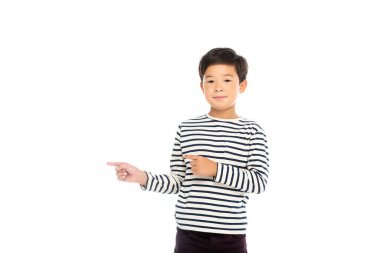 Asian boy looking at camera while pointing with fingers isolated on white stock vector