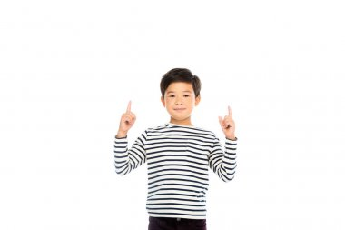 Smiling asian boy pointing with fingers up isolated on white stock vector