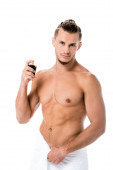 sexy shirtless man in towel with perfume isolated on white