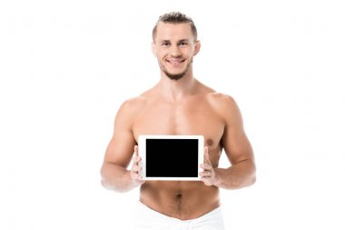 Smiling sexy shirtless man in towel presenting digital tablet isolated on white stock vector