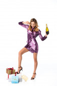 Photo smiling elegant woman in sequin dress with champagne and gifts isolated on white