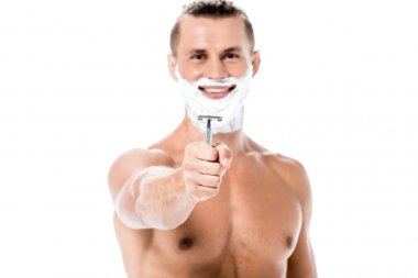 Smiling sexy shirtless man with foam on face holding razor isolated on white stock vector