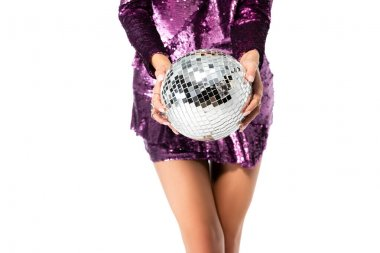 Cropped view of elegant woman in sequin dress posing with disco ball isolated on white stock vector
