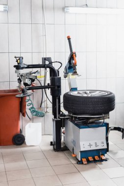 car wheel on tire replacement machine in workshop