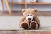 Teddy bear on floor on blurred background