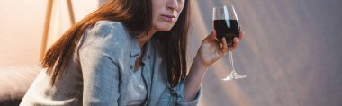 Cropped view of alcohol-addicted woman holding glass of red wine, banner stock vector