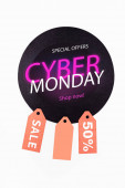 Top view of circle with special offers, cyber monday lettering near price tags and on white background
