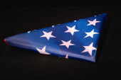 american flag on black background, funeral concept