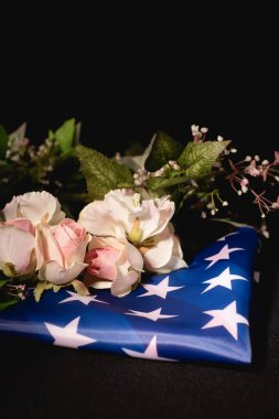 Rose bouquet and american flag on black background, funeral concept stock vector