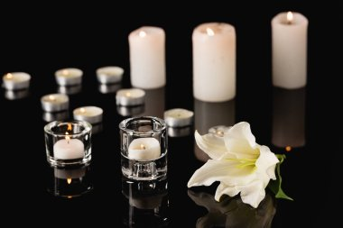 Lily, candles on black background, funeral concept stock vector