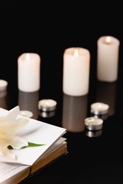 Lily, candles and holy bible on black background, funeral concept stock vector