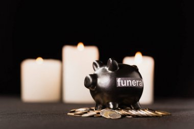 Piggy bank with coins on black background, funeral concept stock vector