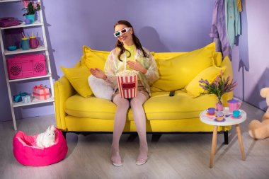 Smiling young woman posing as doll with popcorn in 3d glasses on yellow couch stock vector